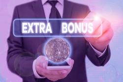 Handwriting text Extra Bonus. Concept meaning an extra amount of money that is added to someone s is pay Elements of this image furnished by NASA.