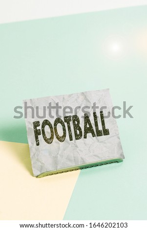 Handwriting text Football. Concept meaning any of various forms of team game involving kicking a ball Paper placed tilted above buffer wire on soft pastel multi colours backdrop. Stock fotó ©