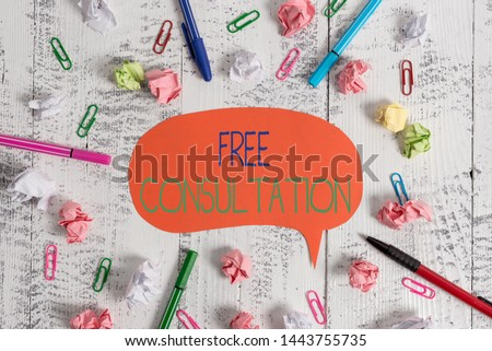Handwriting text Free Consultation. Concept meaning Giving medical and legal discussions without pay Blank speech bubble pens clips crushed paper balls vintage retro table.