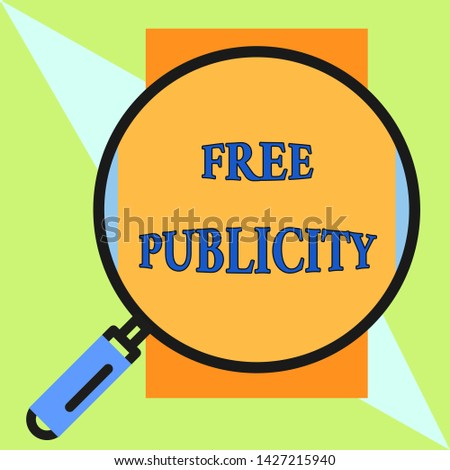 Handwriting text Free Publicity. Concept meaning Promotional marketing Mass media Public Relations Editorial Round magnifying glass with iron handle frame to make object look bigger.