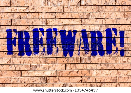 Handwriting text Freeware. Concept meaning Software Application that is available for use at no monetary cost Brick Wall art like Graffiti motivational call written on the wall.