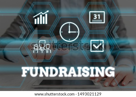 Handwriting text Fundraising. Concept meaning act of collecting or producing money for a particular purpose Woman wear formal work suit presenting presentation using smart device.