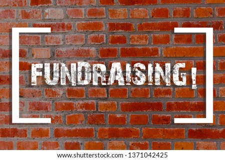 Handwriting text Fundraising. Concept meaning seeking to generate financial support for charity or cause Brick Wall art like Graffiti motivational call written on the wall. #1371042425