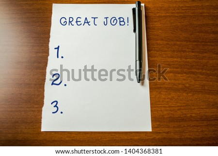 Handwriting text Great Job. Concept meaning used praising someone for something they have done very well Upper view blank stationary paper lying wooden table pen. Writing essay. #1404368381