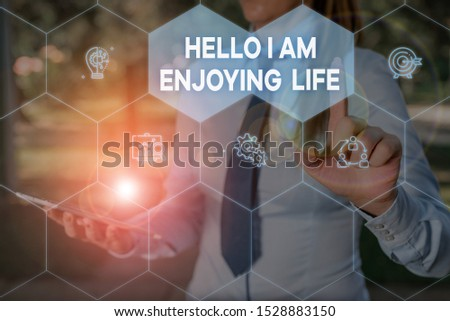 Handwriting text Hello I Am Enjoying Life. Concept meaning Happy relaxed lifestyle Enjoy simple things Woman wear formal work suit presenting presentation using smart device.