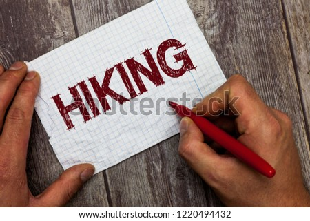 Handwriting text Hiking. Concept meaning walk for long distance especially across country on foot Kind sport #1220494432