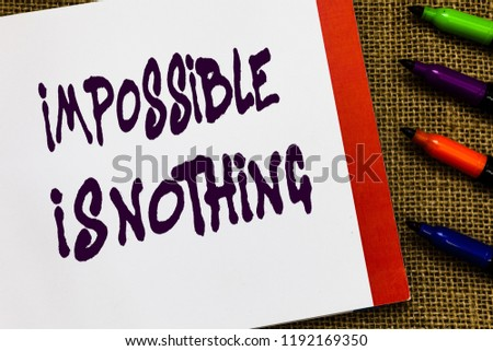 Handwriting text Impossible Is Nothing. Concept meaning Anything is Possible Believe the Realm of Possibility Open notebook page jute background colorful markers Expressing ideas. #1192169350
