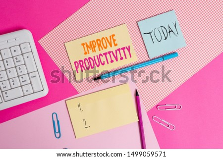 Handwriting text Improve Productivity. Concept meaning to increase the machine and process efficiency Writing equipments and computer stuffs placed above colored plain table.