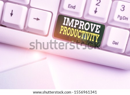 Handwriting text Improve Productivity. Concept meaning to increase the machine and process efficiency White pc keyboard with empty note paper above white background key copy space.