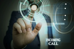 Handwriting text Incoming Call. Concept meaning Inbound Received Caller ID Telephone Voicemail Vidcall Male human wear formal work suit presenting presentation using smart device.