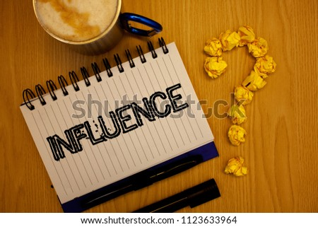 Handwriting text Influence. Concept meaning Capacity to have effect on others character development behavior Ideas grunge notebook coffee cup crumpled papers equal sign wooden wood.