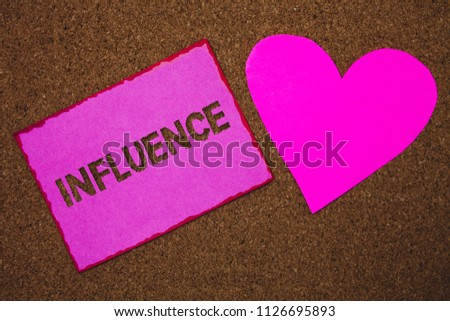 Handwriting text Influence. Concept meaning Capacity to have effect on others character development behavior Paper heart ideas messages cork background love lovely dedication thoughts.