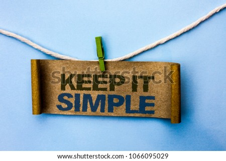 Handwriting text Keep It Simple. Concept meaning Simplify Things Easy Understandable Clear Concise Ideas written Cardboard Paper hanging on rope the plain background Clip.