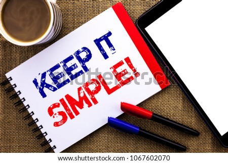 Handwriting text Keep It Simple Motivational Call. Concept meaning Simplify Things Easy Clear Concise Ideas written on Notebook Book on the jute background Tablet Coffee Cup and Pens next to it.