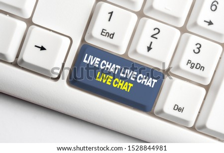 Handwriting text Live Chat Live Chat Live Chat. Concept meaning talking with showing friends relatives online White pc keyboard with empty note paper above white background key copy space.