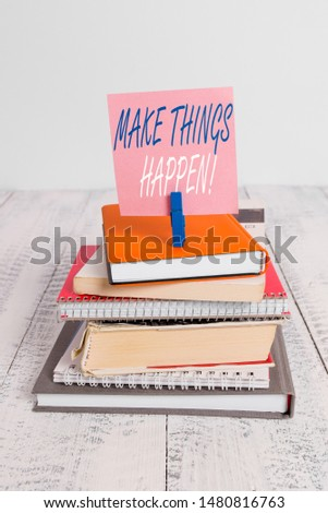 Handwriting text Make Things Happen. Concept meaning you will have to make hard efforts in order to achieve it pile stacked books notebook pin clothespin colored reminder white wooden.