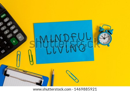 Handwriting text Mindful Living. Concept meaning Fully aware and engaged on something Conscious and Sensible Clipboard sheet clips note calculator pencil alarm clock colored background. #1469885921