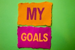 Handwriting text My Goals. Concept meaning Goal Aim Strategy Determination Career Plan Objective Target Vision written on Tear Papers on the Green background.
