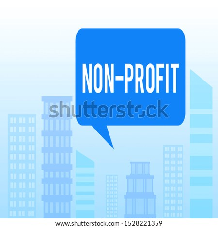 Handwriting text Non Profit. Concept meaning providing products or service without paying back in return Outdoor Cityscape Urban View Skyscrapers in Pastel Blue Unclouded Skies.