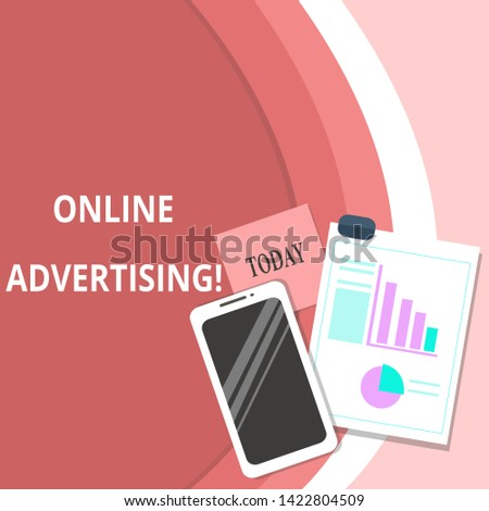 Handwriting text Online Advertising. Concept meaning Internet Web Marketing to Promote Products and Services Layout Smartphone Off Sticky Notes Clipboard with Pie Chart and Bar Graph.
