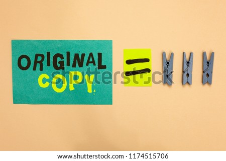 Handwriting text Original Copy. Concept meaning Main Script Unprinted Branded Patented Master List Turquoise paper reminder equal sign several clothespins sending message. #1174515706