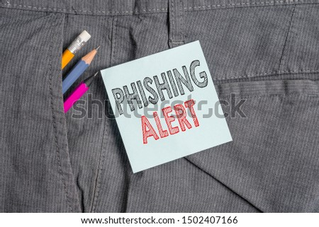 Handwriting text Phishing Alert. Concept meaning aware to fraudulent attempt to obtain sensitive information Writing equipment and blue note paper inside pocket of man work trousers.