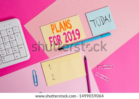 Handwriting text Plans For 2019. Concept meaning an intention or decision about what one is going to do Writing equipments and computer stuffs placed above colored plain table. #1499059064