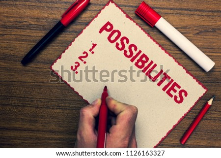 Handwriting text Possibilities. Concept meaning Things that may happen or be the case State of being possible Three marker pens nice small pitch art paper lovely love ideas wood shadow.