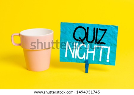 Handwriting text Quiz Night. Concept meaning evening test knowledge competition between individuals Cup empty paper blue clothespin rectangle shaped reminder yellow office.