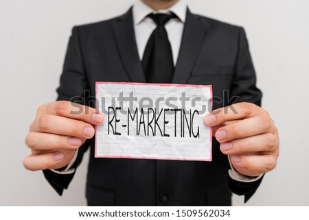 Handwriting text Re Marketing. Concept meaning Strategy to reach potential customers in your website.