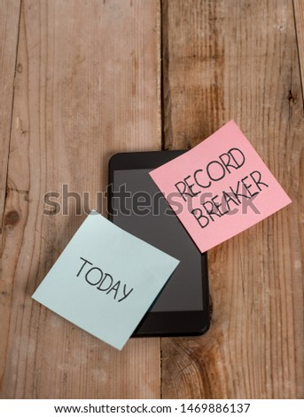 Handwriting text Record Breaker. Concept meaning someone or something that beats previous best result Smartphone two colored sticky notes lying vintage old wooden background. #1469886137