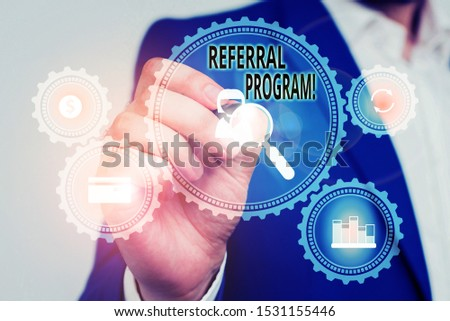 Handwriting text Referral Program. Concept meaning internal recruitment method employed by organizations Male human wear formal work suit presenting presentation using smart device. #1531155446