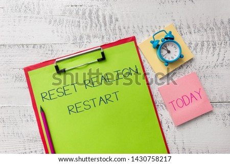 Handwriting text Reset Realign Restart. Concept meaning Life audit will help you put things in perspectives Metal clipboard sheets marker alarm clock notes pad wooden background. #1430758217