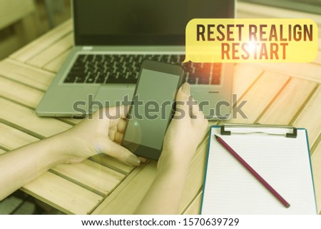 Handwriting text Reset Realign Restart. Concept meaning Life audit will help you put things in perspectives woman laptop computer smartphone office supplies technological devices. #1570639729
