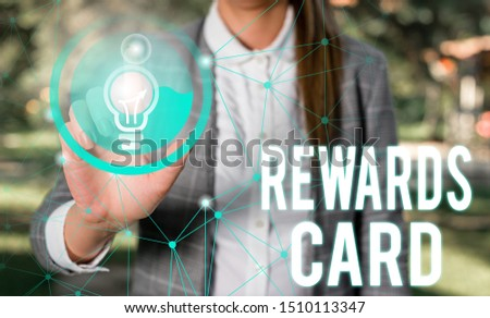 Handwriting text Rewards Card. Concept meaning Help earn cash points miles from everyday purchase Incentives Female human wear formal work suit presenting presentation use smart device. #1510113347