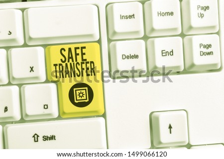 Handwriting text Safe Transfer. Concept meaning Wire Transfers electronically Not paper based Transaction White pc keyboard with empty note paper above white background key copy space. #1499066120