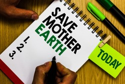 Handwriting text Save Mother Earth. Concept meaning doing small actions prevent wasting water heat energy Diary pen notepad ring pen marker pointer script daily work handwriting.
