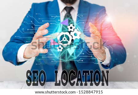 Handwriting text Seo Location. Concept meaning process to optimize pages on your site to show for organic Male human wear formal work suit presenting presentation using smart device.