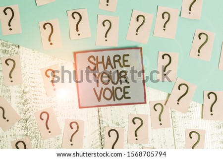 Handwriting text Share Your Voice. Concept meaning asking employee or member to give his opinion or suggestion Scribbled and crumbling papers with thick cardboard above wooden table.