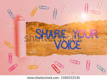 Handwriting text Share Your Voice. Concept meaning asking employee or member to give his opinion or suggestion Paper clip and torn cardboard placed above a wooden classic table backdrop.