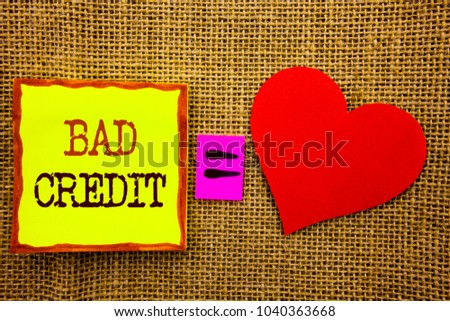 Handwriting text showing Bad Credit. Business concept for Poor Bank Rating Score For Loan Finance written Stiky Note Paper Meaning Love For the textured background