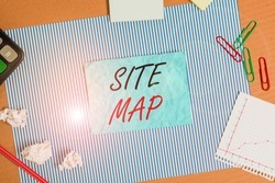 Handwriting text Site Map. Concept meaning designed to help both users and search engines navigate the site Striped paperboard notebook cardboard office study supplies chart paper.