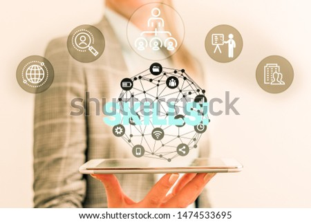 Handwriting text Skills. Concept meaning ability do something very well by nature Male human wear formal work suit presenting presentation using smart device. #1474533695