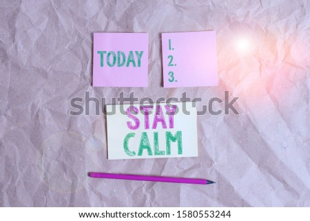 Handwriting text Stay Calm. Concept meaning Maintain in a state of motion smoothly even under pressure Papercraft craft paper desk square spiral notebook office study supplies.