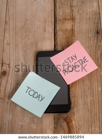 Handwriting text Stay Proactive. Concept meaning Taking own decision to go ahead of anticipated events Smartphone two colored sticky notes lying vintage old wooden background. #1469885894