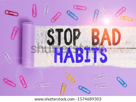 Handwriting text Stop Bad Habits. Concept meaning asking someone to quit doing non good actions and altitude Paper clip and torn cardboard placed above a wooden classic table backdrop.