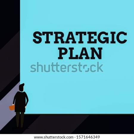 Handwriting text Strategic Plan. Concept meaning A process of defining strategy and making decisions Back view young woman watching blank big rectangle. Geometrical background.
