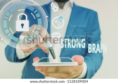Handwriting text Strong Brain. Concept meaning own firm attitudes and opinions and are not easily influenced Male human wear formal work suit presenting presentation using smart device.