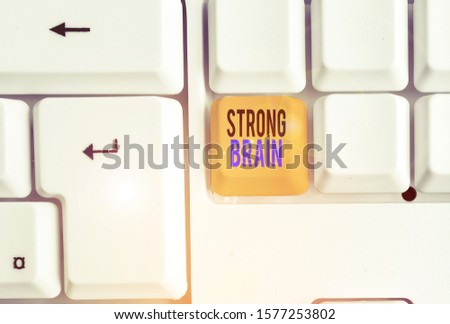 Handwriting text Strong Brain. Concept meaning own firm attitudes and opinions and are not easily influenced White pc keyboard with empty note paper above white background key copy space.