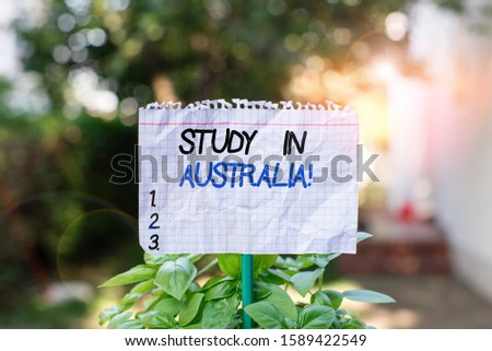 Handwriting text Study In Australia. Concept meaning going into foreign country order complete your studies Plain empty paper attached to a stick and placed in the green leafy plants.